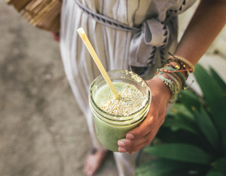 Lady holding green smoothie